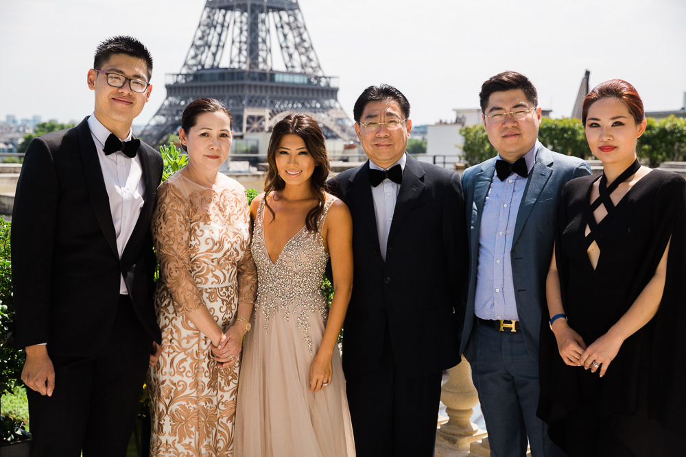 Family portraits at Eiffel Tower during destination wedding in Paris