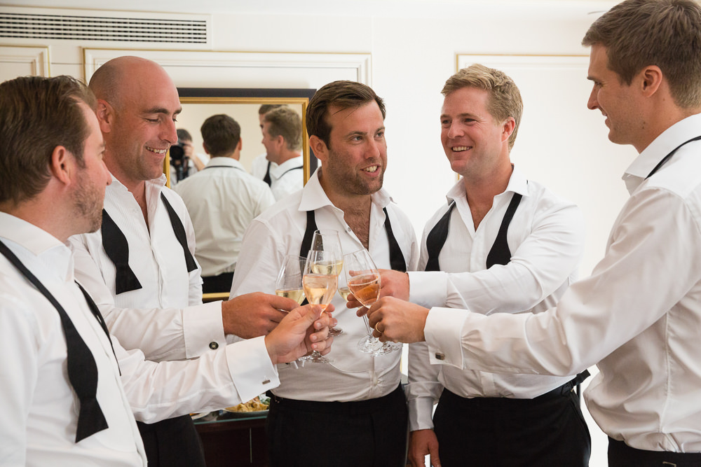 Groom and groomsmen getting ready with champagne glasses