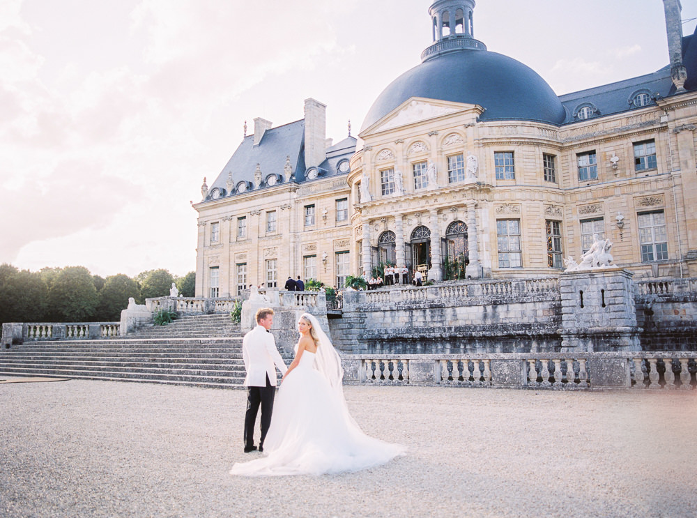 French Wedding - Bride and groom walking to their French Chateau wedding