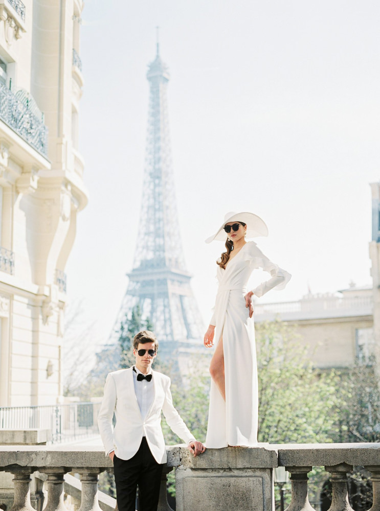 Fashionable couple posing for engagement photos before the wedding