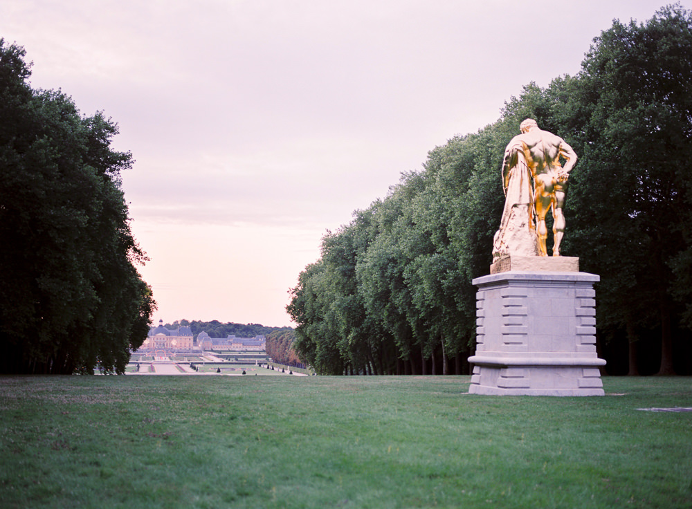 Golden statue in the gardens of the Chateau Vaux le Vicomte