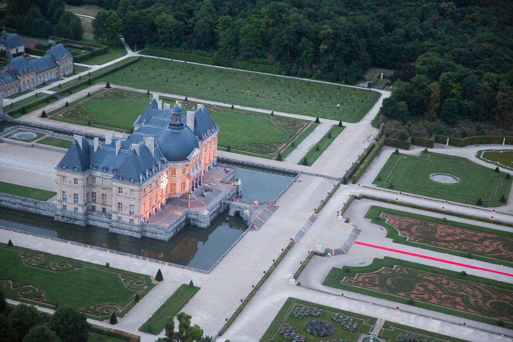 Aerial view of the Chateau Vaux le Vicomte and its gardens during a wedding reception