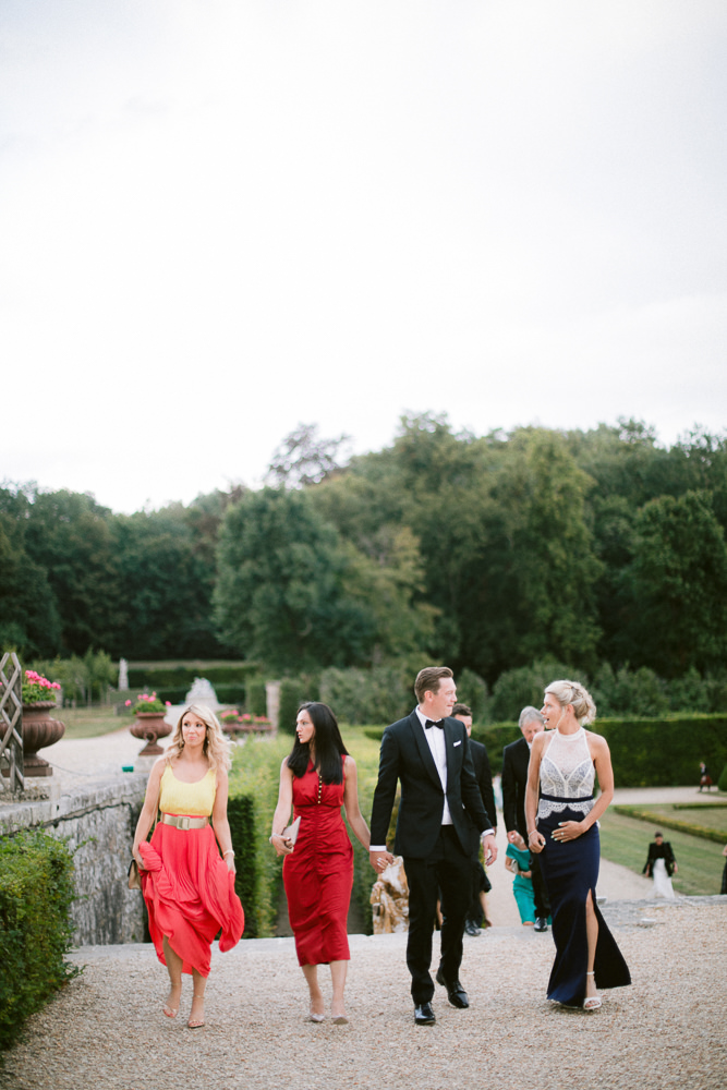 Stylish guests at a luxury wedding in a private French chateau